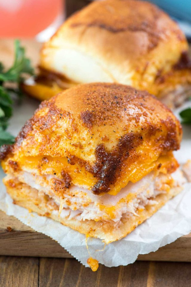 BBQ Turkey Cheddar Sliders - this easy sliders recipe is full of turkey, cheese, and barbecue flavoring! The topping tastes JUST like a BBQ chip!