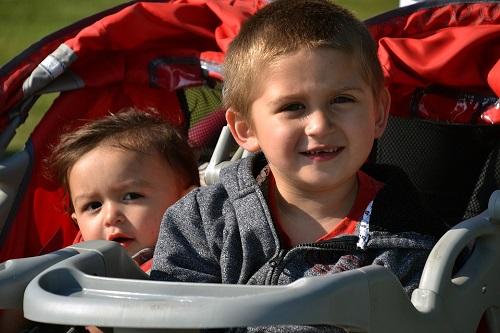 two kids in stroller