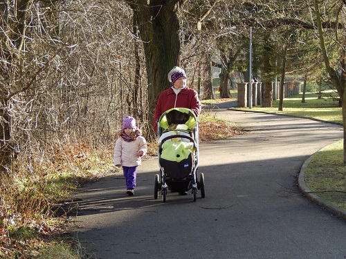 grandmother and a girl walking on the park